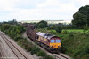 Engineering work near Llanwern on 13th September 2008 necessitated a reversal for trains to/from Llanwern Steelworks at Severn Tunnel Junction. 66129 heads 6M88, 0913 Llanwern to Dee Marsh over Bishton Flyover; 66037 is at the rear.