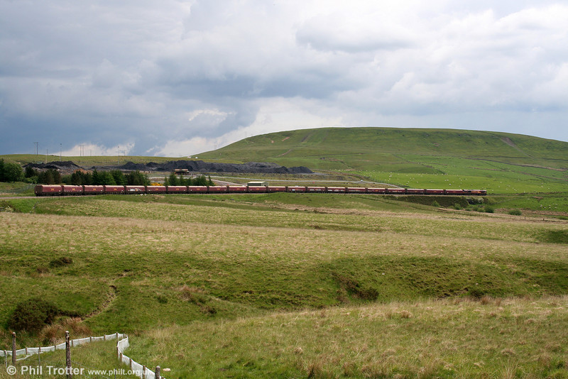Fochriw Mountain forms a backdrop to 66147 with its 21 HTAs as they head for Aberthaw Power Station (6C93) on 31st May 2008. The line in this bleak landscape once terminated at Dowlais (Cae Harris) and in the 1930s boasted five trains a day in each direction from Ystrad Mynach. The passenger service was withdrawn from 15th June 1964 and the line beyond Cwmbargoed to Dowlais was taken out of use in 1983.