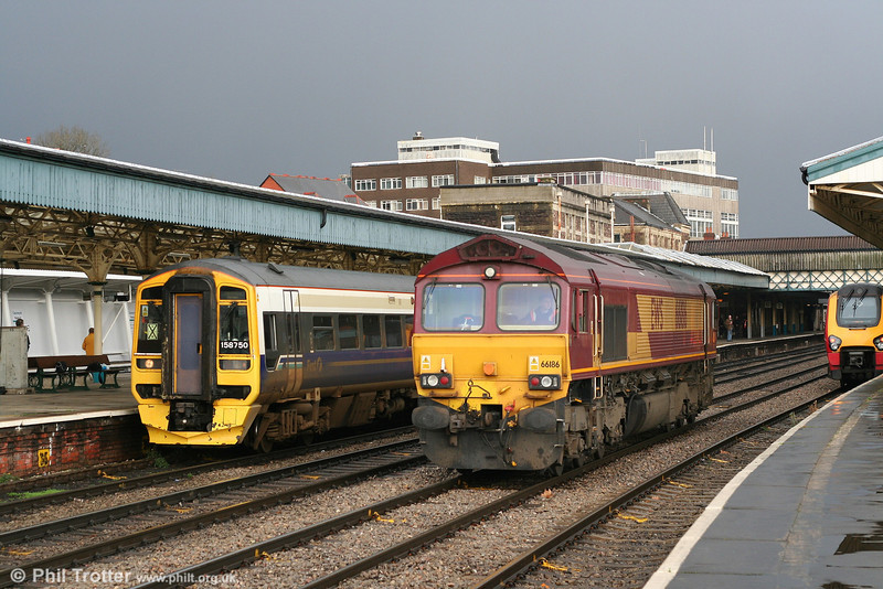 A hailstorm is in the offing as hybrid-liveried 158750 (forming the 1107 Taunton to Cardiff) and 66186 (running light to ADJ) pass simultaneously through Newport on 5th January 2008.
