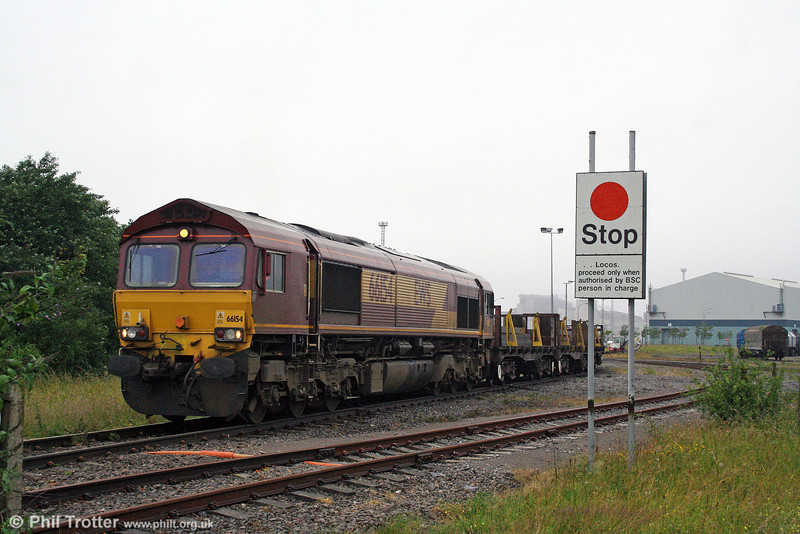 66154 emerges from Port Talbot steelworks with slabs destined for Llanwern on 27th June 2008.