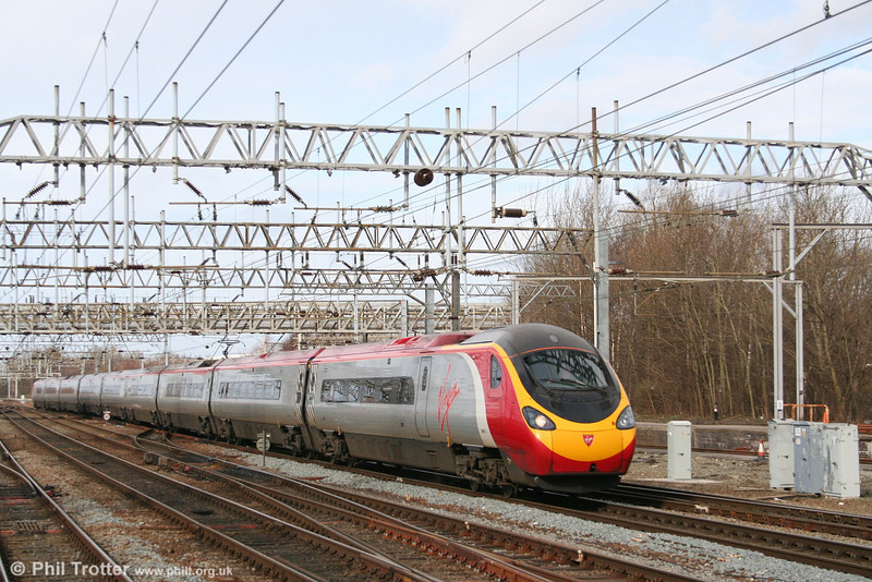 Virgin Pendolino 390011 'City of Lichfield' approaches Crewe with a service for Milton Keynes on 1st March 2008. An emergency West Coast timetable was being operated, as a consequence of containers being blown (!) from intermodal services at Shap and Ledburn.