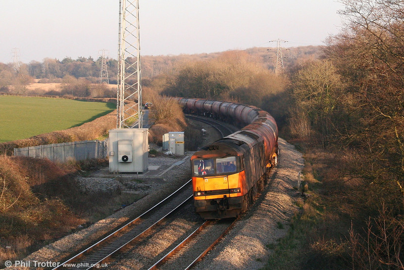 Load Haul liveried 60059 'Swinden Dalesman' at Llangewydd with 6B33, 1212 Theale to Margam empty Murco tanks on 16th February 2008.