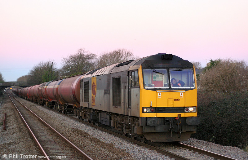 One of very few freight movements in South Wales on 27th December 2008 was 6B13, 0510 Robeston to Westerleigh loaded tanks. 60099 'Ben More Assynt' is seen at Pyle West just after sunrise. It was at approximately this point that the former Pyle West Curve (1947 - 1965) left the main line to the left of the picture, providing a direct facility to Porthcawl from the Swansea direction.