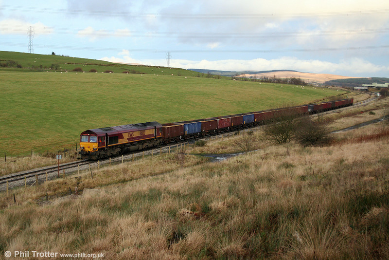 66132 progresses away from Onllwyn at the head of 6F81, 1520 Onllwyn to Margam empty MEAs on 13th December 2008.