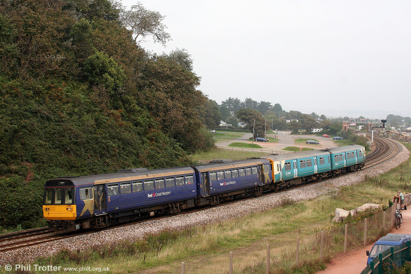 An unusual pairing; FGW's 142004 and sub leased ATW 150267 pass Langstone Rock, Dawlish Warren forming 2T14, 1020 Exmouth to Paignton on 30th August 2008. The train was strengthened as a consequence of the large numbers attending the Port of Dartmouth Royal Regatta.