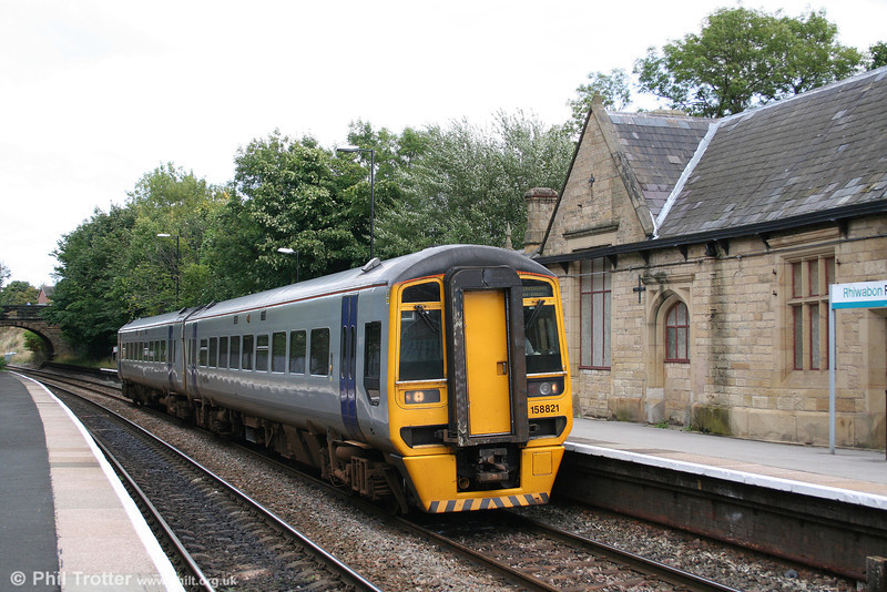 ATW 158821 calls at Ruabon forming the 1128 Chester to Birmingham New Street on 1st September 2008.