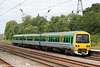 Displaying the former Central Trains livery, 323213 arrives at Longbridge forming the 1436 Lichfield City to Redditch on 28th May 2008.