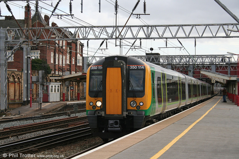 2008 is the year of new liveries. 350114 carries the new London Midland colours as it departs from Crewe forming the 1221 Birmingham New Street to Liverpool Lime Street on 1st March 2008.