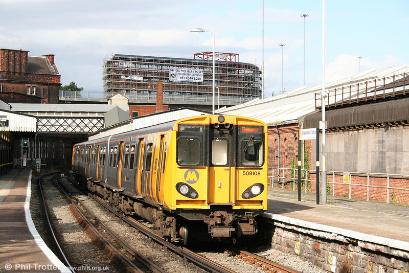 508108 at Birkenhead Central forms the 1611 Liverpool to Chester on 1st September 2008.