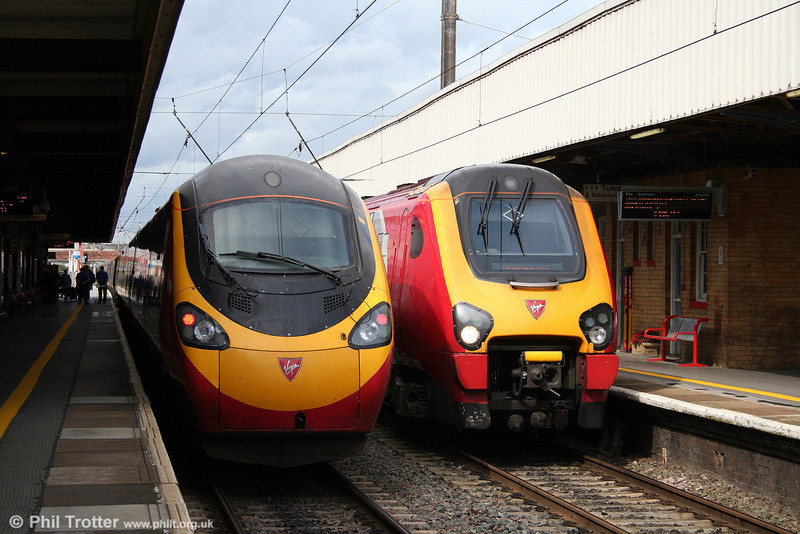 A comparison of Pendolino and Voyager front ends! 390038 'City of London' working the 1246 London Euston to Lancaster meets 221143 'Auguste Picard' on the 1152 Edinburgh to Birmingham New Street at Warrington on 2nd September 2008.