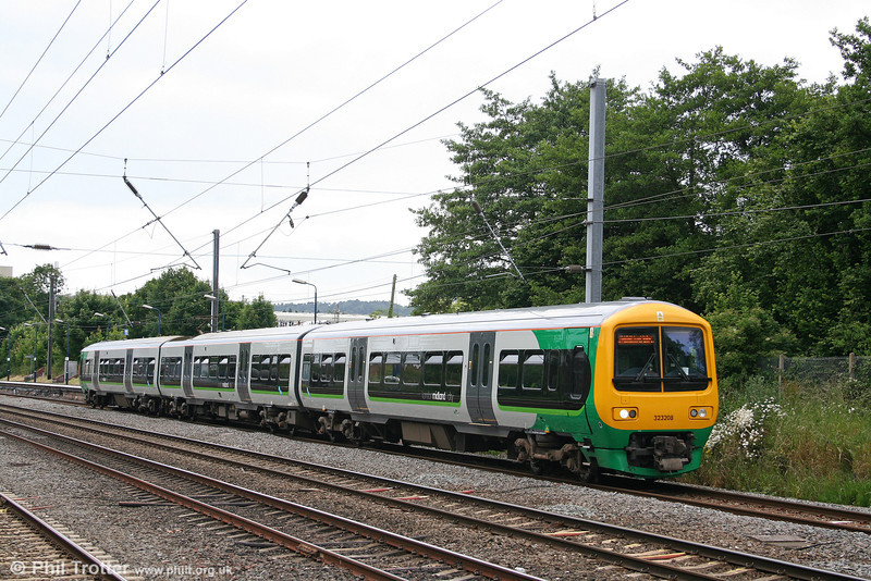 Carrying the new London Midland livery, 323208 departs from Longbridge as the 1457 Redditch to Lichfield Trent Valley on 28th June 2008.