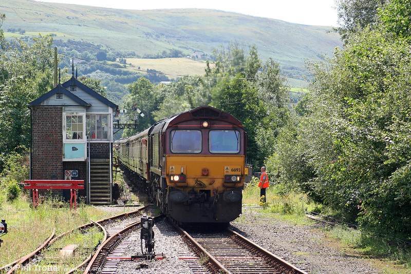 The signalman has handed over the token to the driver of 66193 at Pantyffynnon, heading UK Railtours 1Z66, 0738 London Paddington to Llandrindod Wells, 'The Heart of Wales Line' on 2nd August 2008.