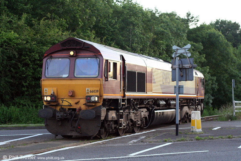 66039 moves out from the Ford Branch to cross the A48 and enter the works yard as 0B46, 1859 Newport ADJ to Bridgend Ford Sidings on 10th June 2008. The 1¼ mile Ford Branch opened in January 1980.