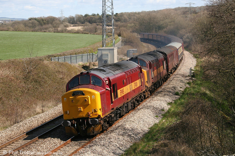 Recently repainted 37401 with 37417 'Richard Trevithick' pass Llangewydd with 5Z70, 1241 Cardiff Central - Newport - Margam ECS on 12th April 2008. The pair had previously hauled this stock as 1Z70, Compass Tours' 0510 Blackburn to Cardiff Central via Llandrindod Wells, 'The Heart of Wales Explorer'.