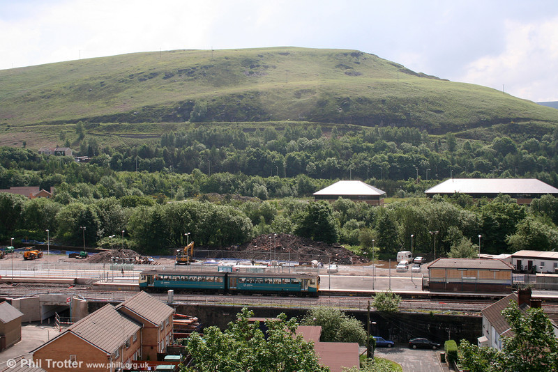Although taken into the sun, this view shows the overall scene at the 'new' Abercynon station, including the now disused signalbox. A class 143 stops forming the 0956 Barry Island to Merthyr Tydfil on 31st May 2008. When Merthyr services are increased to half hourly, Abercynon will enjoy a 15 minute frequency to and from Cardiff.