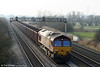 66184 heads its lengthy train of 41 MEAs, forming 6Z39, 1100 Margam to Milford West through Coedkernew on 30th December 2008.