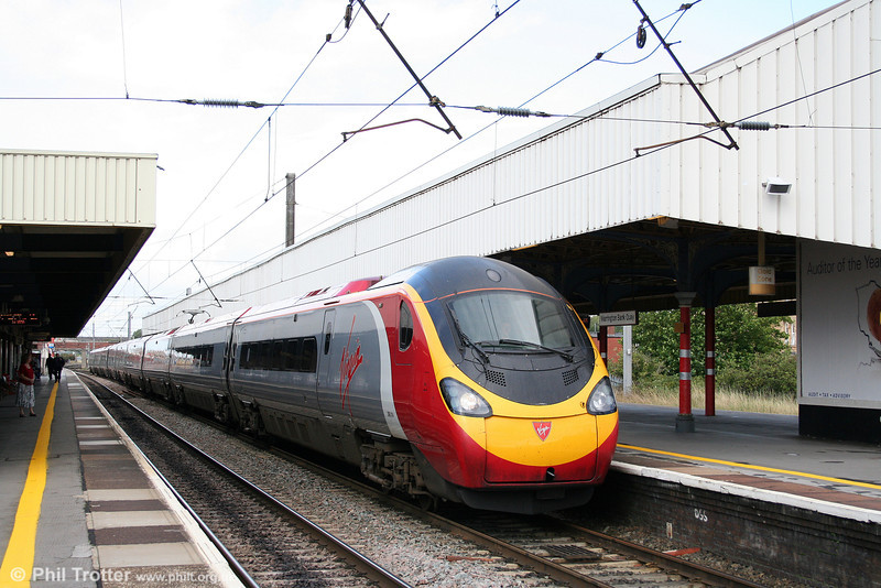 Pendolino 390014 'City of Manchester' calls at Warrington Bank Quay forming the 1110 Glasgow Central to London Euston on 2nd September 2008.