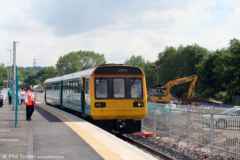 The reopened west platform at what was Abercynon South (now simply Abercynon, since the closure of the North station) is used by trains from both Aberdare and Merthyr. 142083 calls with the 1022 Aberdare to Barry Island on 31st May 2008. A new car park is being added to the right.
