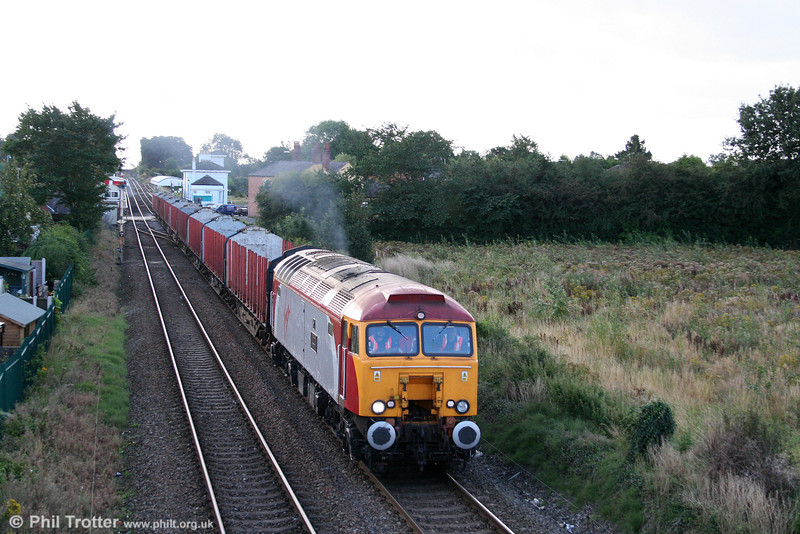 57311 'Parker' accelerates away from Gobowen with 6S19, 1025 Chirk to Carlisle Yard empty timber carriers on 2nd September 2008.
