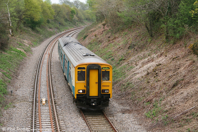 Engineering work between Morlais and Llandeilo Junctions on 4th May 2008 meant that the 1100 Swansea to Shrewsbury started from Pontarddulais. Here, 150242 passes Allt-y-Graban, Swansea District Line with the morning ecs working from Cardiff Canton to Pontarddulais.