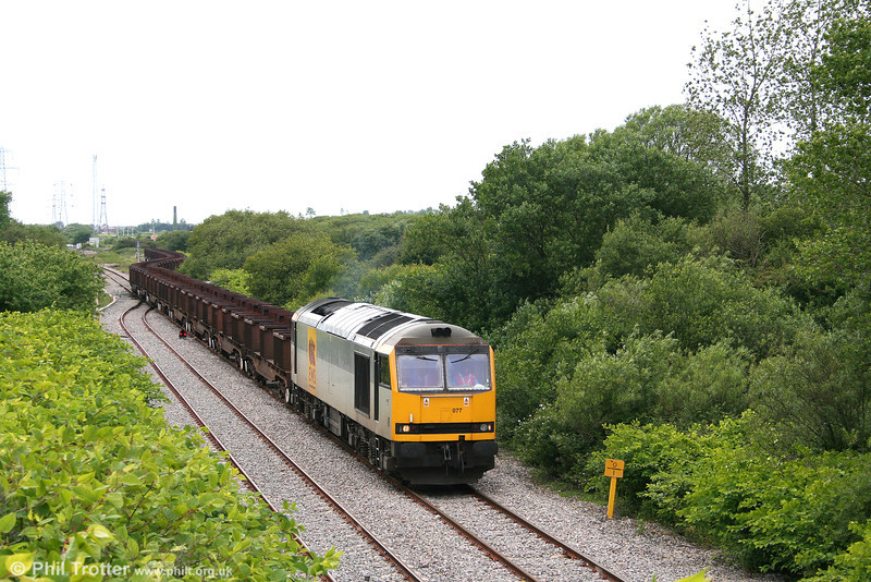 60077 leaves Trostre with 6E20, 1645 Trostre to Doncaster Belmont on 17th June 2008.