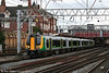 London Midland's 350103 departs from Crewe forming the 1721 Birmingham New Street to Liverpool Lime Street on 2nd September 2008.
