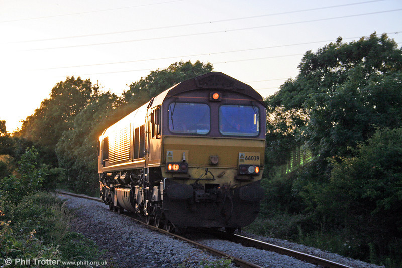 'Challenging' lighting conditions on the seldom photographed Ford Branch at Waterton, Bridgend. 66039 approaches one of several foot crossings running as 0B46, 1859 Newport ADJ to Bridgend Ford Sidings on 10th June 2008.