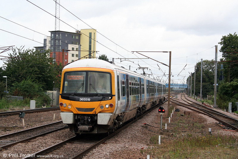 365519 with a livery advertising destinations in Peterbrough, approaches Stevenage forming the 1256 King's Lynn to London King's Cross on 11th September 2008.