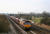 66132 passes Coedkernew with 4C70, 0858 Aberthaw to Portbury empties on 29th December 2008.