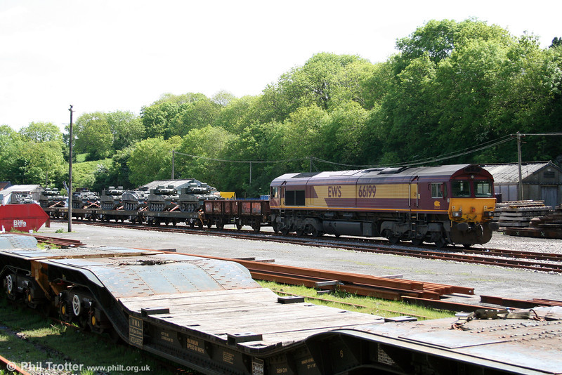 66199 waits in the goods yard at Haverfordwest while its train of British Army Scimitar AFVs is loaded on 19th May 2008. The loco had arrived early that morning as 0Z66, 0338 Didcot to Haverfordwest.