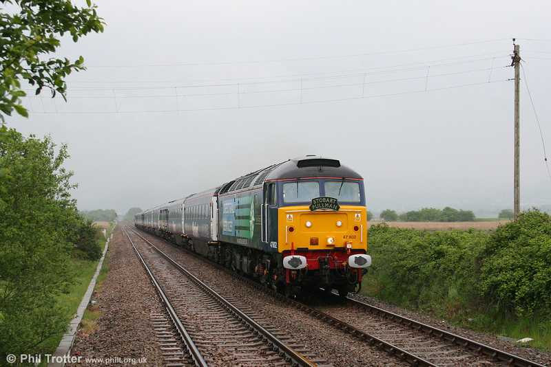 DRS 47802 'Pride of Cumbria' ambles along in the drizzle at Llangennech heading 1Z36, 0742 London Paddington to Carmarthen, 'The Stobart Pullman' on 15th May 2008.