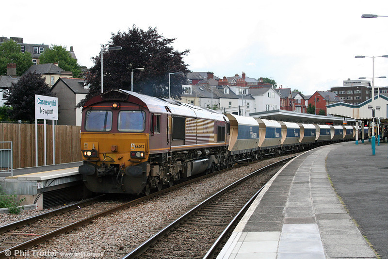 66037 passes through Newport with 6B80, 0622 Westbury Yard to Machen Quarry empty Hanson hoppers on 12th July 2008.