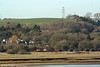 On a sunny February afternoon, Load Haul liveried 60059 'Swinden Dalesman' skirts the Loughor Estuary before turning inland towards Bynea with 6B12, 1421 Margam to Trostre coils. 17th February 2008.