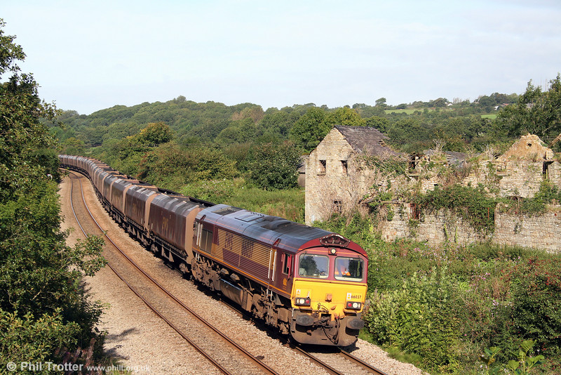 66037 passes Llangewydd in full sun, heading 6O31, 0840 Onllwyn to Aberthaw Power Station on 10th September 2008.