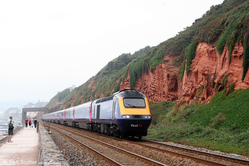 One for the geologists. 43155 is seen at Dawlish heading 1A87, 0955 Penzance to London Paddington on 30th August 2008. The New Red Sandstone deposits at Dawlish were laid in the Permian period, up to 280 million years ago and have been described as the best-exposed non-marine Permian rocks in Western Europe. Now you know.