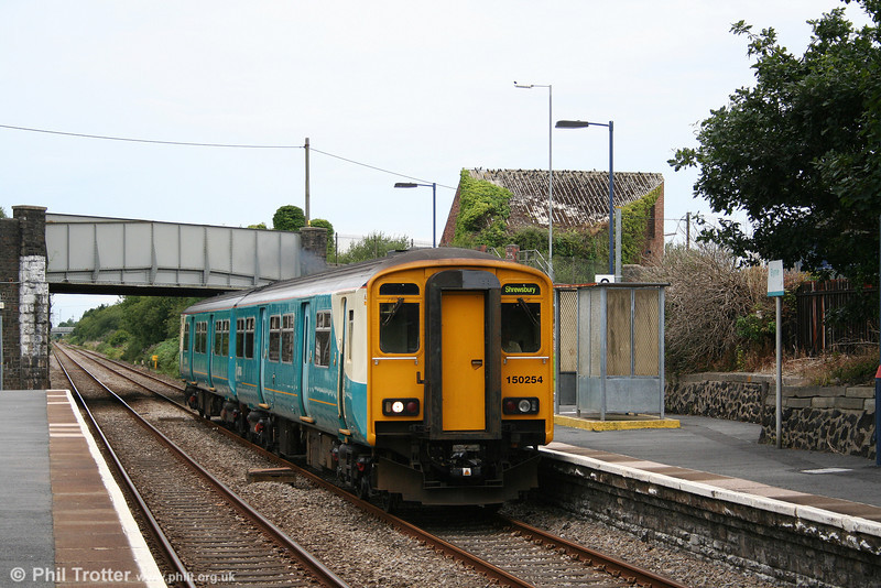 There are no passengers at Bynea for 150254 as it passes with the 1516 Swansea to Crewe on 3rd August 2008.