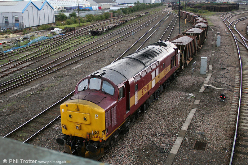 Viewed from Bishopstoke Road bridge, 37401 waits at Eastleigh with a ballast train on 23rd August 2008.
