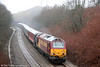 67017 'Arrow' heads 1Z50, 1015 Swansea to Newport 'rugex' through the drizzle at Llansamlet on 23rd February 2008.
