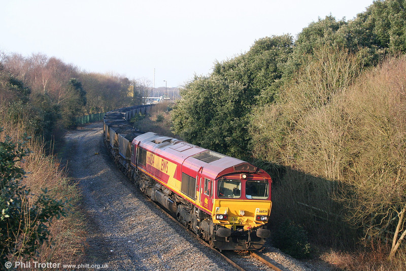 Having run around its train of HAAs, 66034 heads out of Burrows Yard at Jersey Marine with 6O31 from Onllwyn on 16th February 2008.