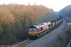 66034 heads past Jersey Marine with 6O31 from Onllwyn to Margam on 16th February 2008.