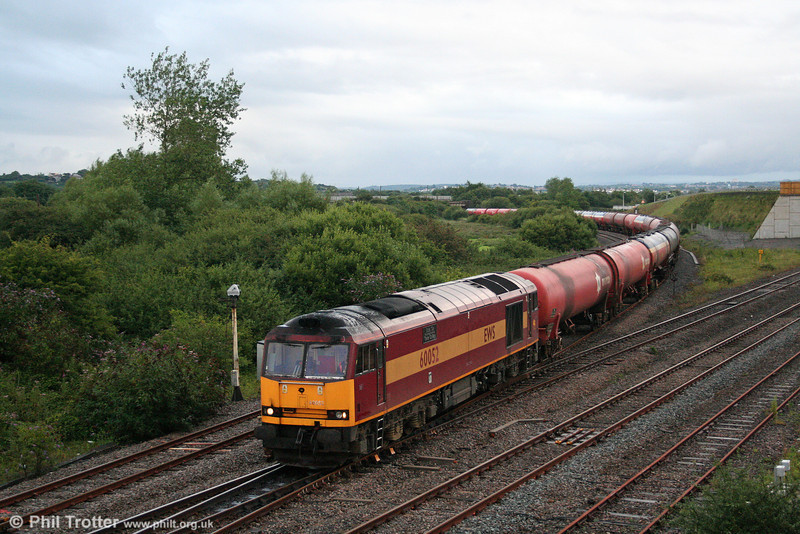 60052 'Glofa Twr/Tower Colliery' between the showers at Llandeilo Junction with 6B33, 1333 Theale to Robeston empties on 7th August 2008.