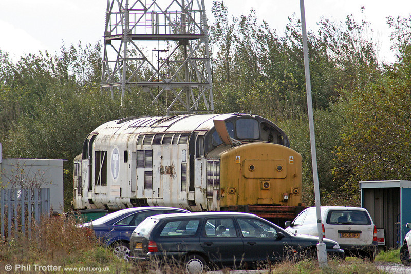 37412, formerly named 'Driver John Elliott', sits at Margam Knuckle Yard on 18th October 2008, awaiting movement by road. The loco was moved to Barrow Hill for reinstatement by DRS on 28th October. The loco was placed in store at Margam in October 2002.