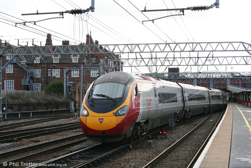 Pendolino 390019 'Virgin Warrior' heads north out of Crewe on 1st March 2008.