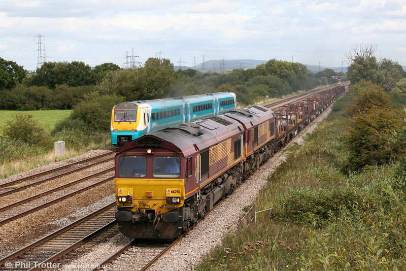 66250 and 66237 head through Coedkernew with 6V40, 0211 Lackenby to Margam slabs on 29th August 2009.