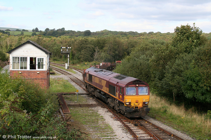 Having run round its train on the Garw Loop, 66051 departs from Tondu with the diverted 6E37, 1401 Margam to Lackenby on 13th September 2009.