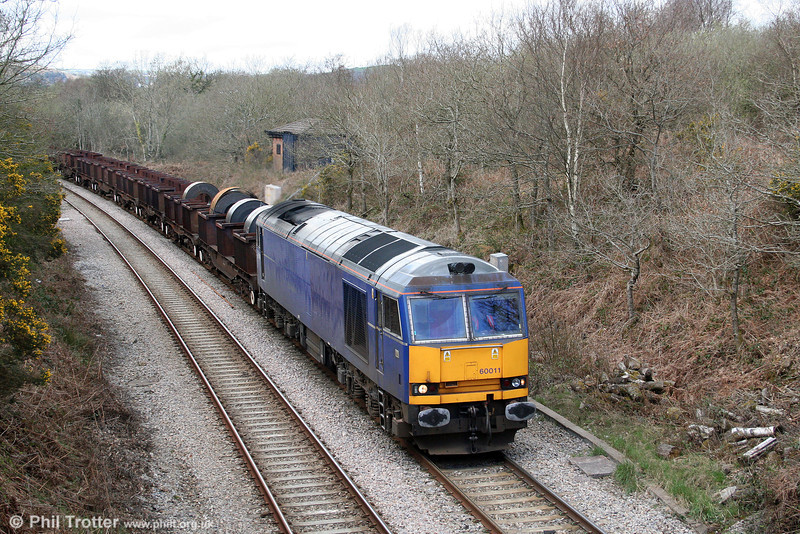 60011 passes Allt y Graban with the return Trostre to Margam working on 4th April 2009.