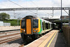 London Midland's fleet of Siemens 'Desiro' emus now dominate stopping services on the WCML. One of the first series, 350106 departs from Tamworth forming the 1146 London Euston to Crewe on 3rd August 2009.