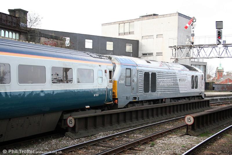 67015 'David J Lloyd' departs from Shrewsbury at the head of 1J86, 1124 London Marylebone to Wrexham General on 14th March 2009.
