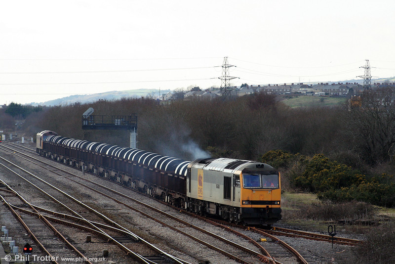 Having arrived at Llandeilo Junction behind 60024, 60072 'Cairn Toul' takes the lead of 6B12, 1414 Margam to Trostre as it runs onto the Genwen Loop before again reversing into Trostre Works. 1st February 2009.