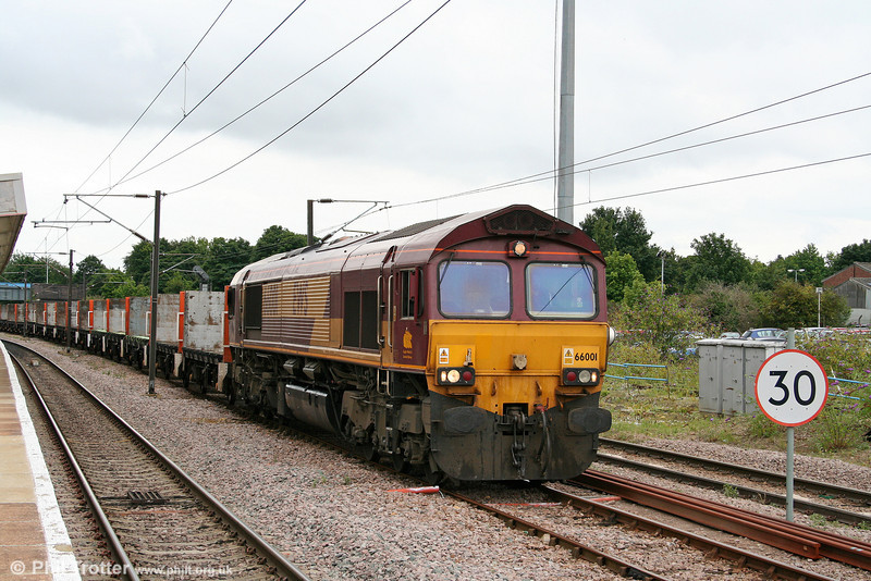Class pioneer 66001 arrives at Peterborough with 4D56, 1341 Biggleswade to Heck empty Plasmor wagons on 4th August 2009.